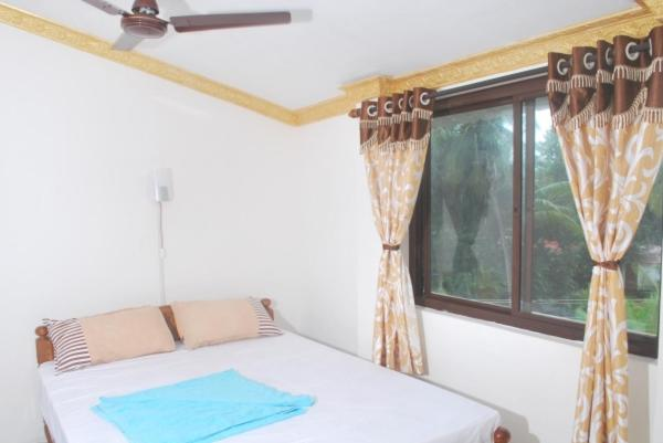 A bed or beds in a room at Gabriel Guest House