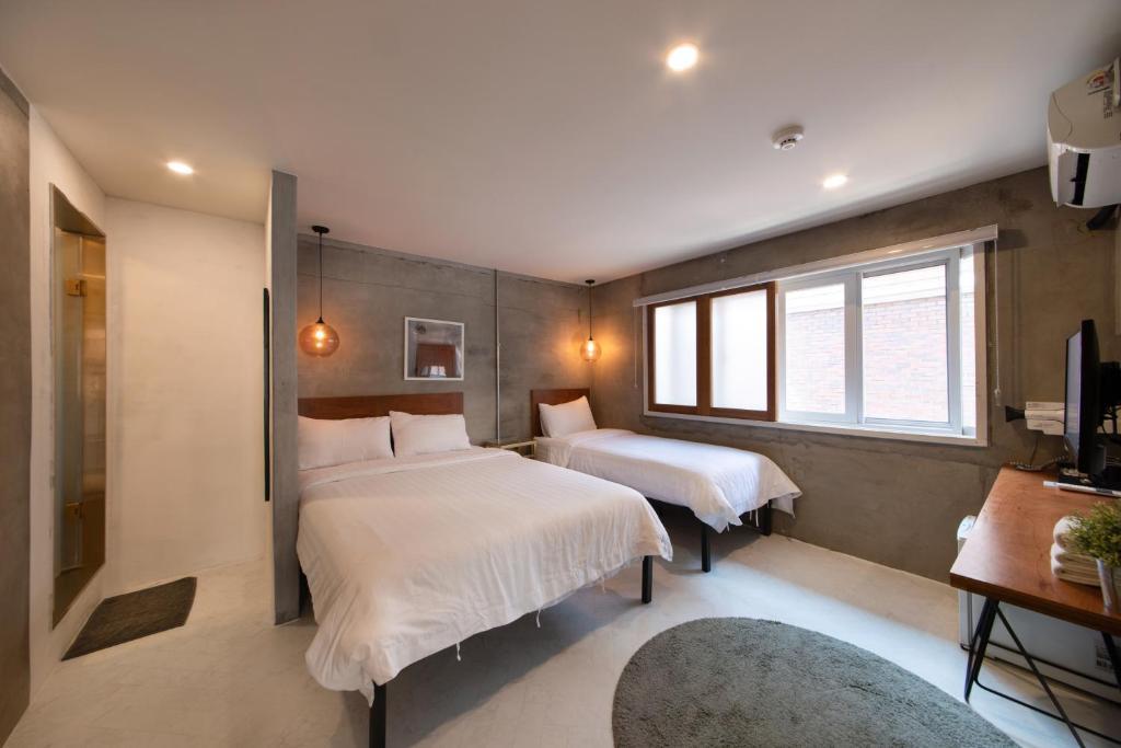 Gulta vai gultas numurā naktsmītnē Hotel Baroato
