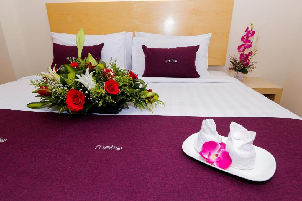 A bed or beds in a room at Metro Hotel @ KL Sentral