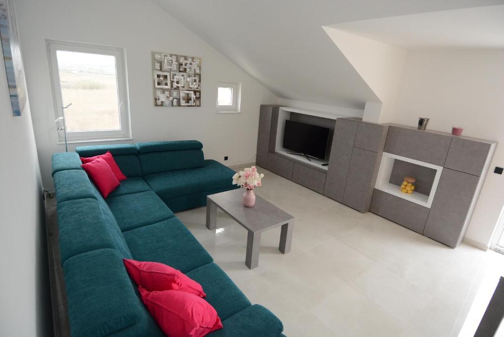 A seating area at Apartmani Rea