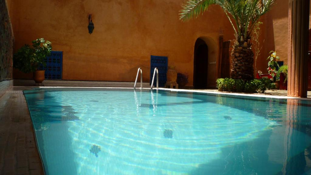 The swimming pool at or near Riad Timadrouine