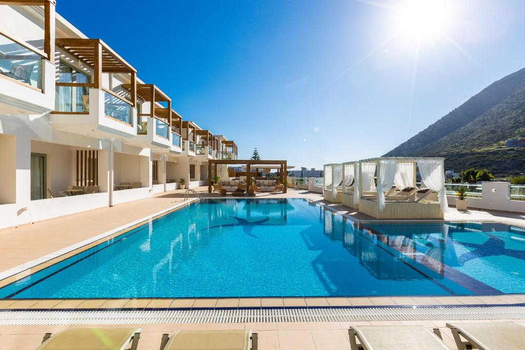 The swimming pool at or close to Nostos Beach Boutique Hotel