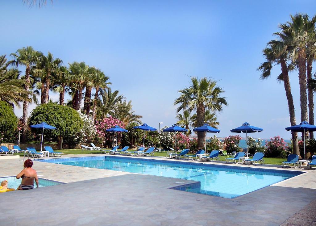 The swimming pool at or near Rododafni Beach Apartments