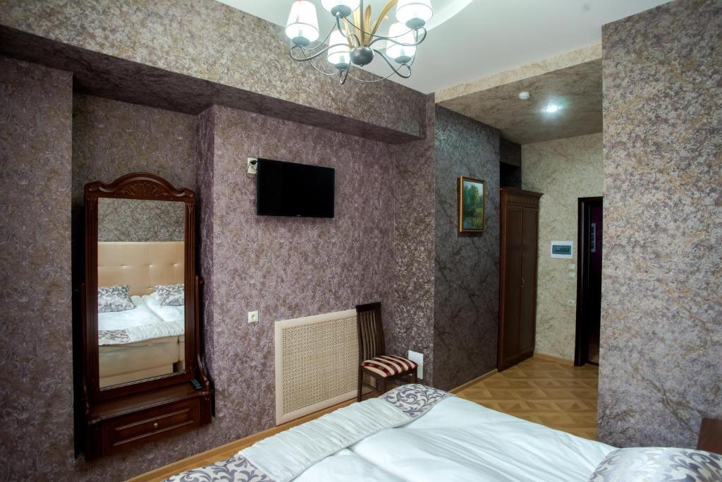 Телевизор и/или развлекательный центр в Hotel Vintage