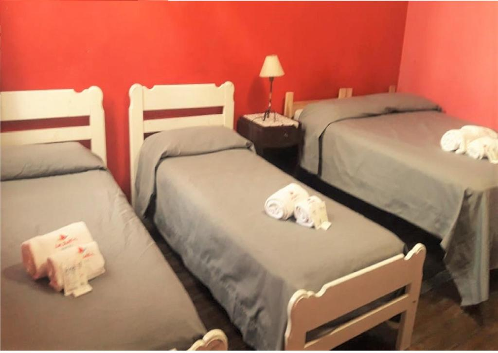 A bed or beds in a room at La Barca Hotel