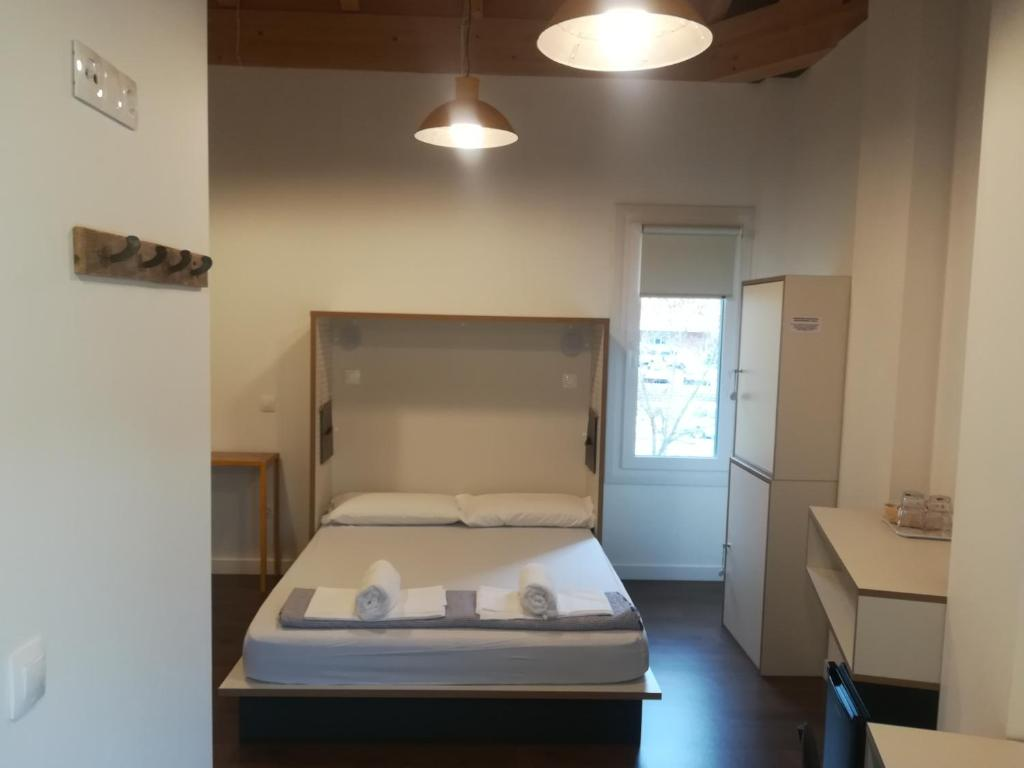 A bed or beds in a room at Agora Hostel