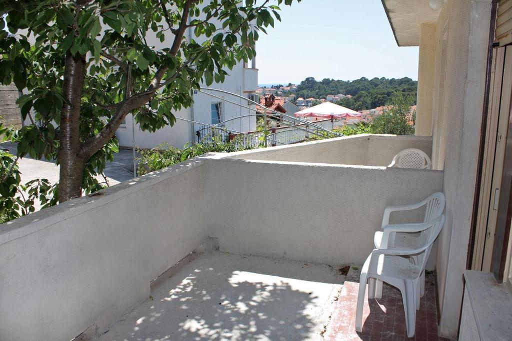 A balcony or terrace at Apartments and rooms with parking space Palit (Rab) - 3195