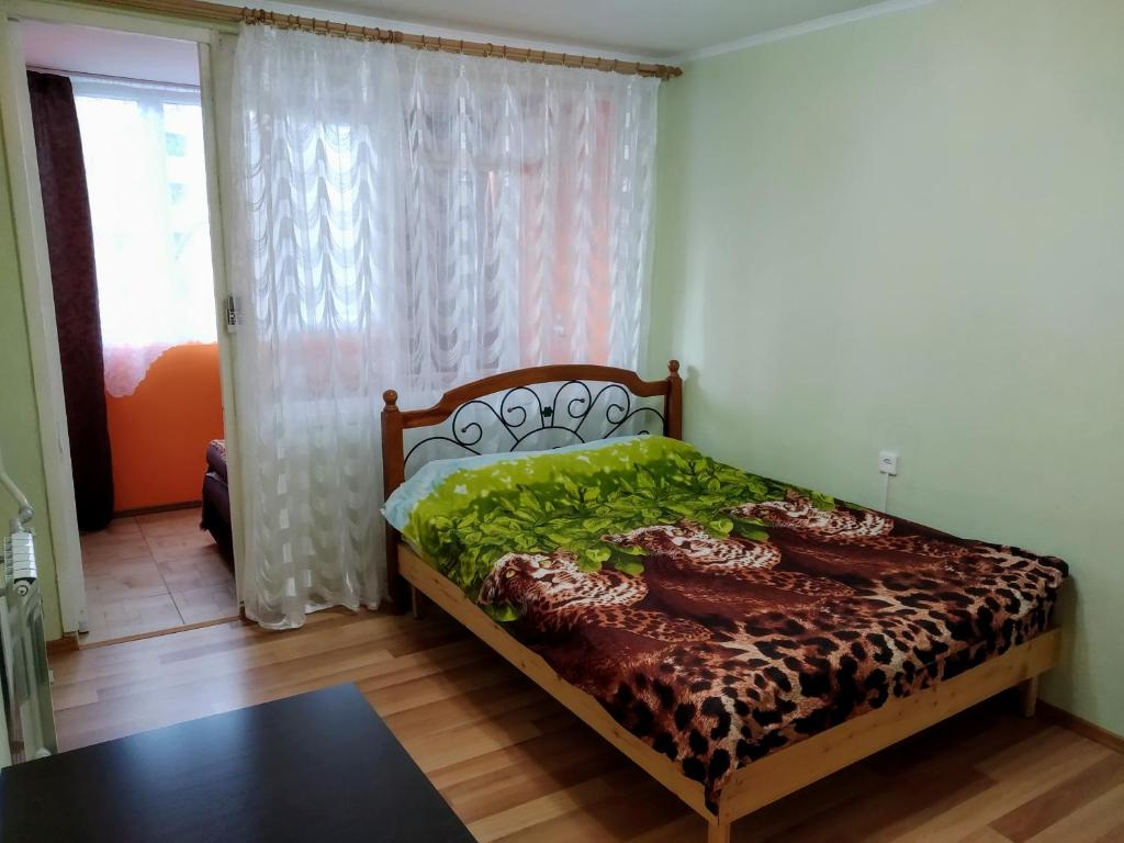 A bed or beds in a room at Комната в квартире на Павлова