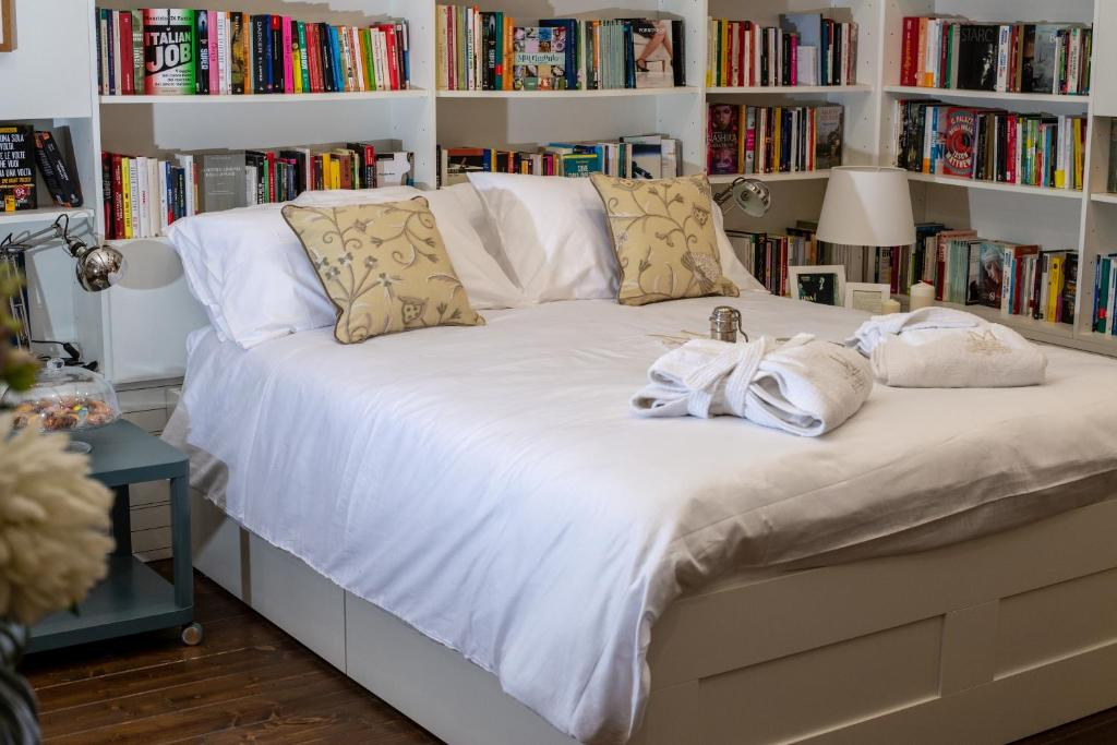 Letto o letti in una camera di BED&BOOK Mooks