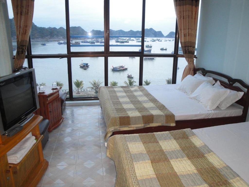 A bed or beds in a room at Phuong Mai Family Hotel