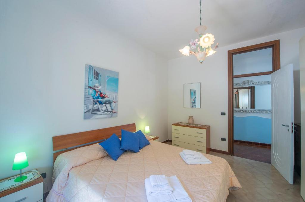 A bed or beds in a room at Casa vacanza Thalia