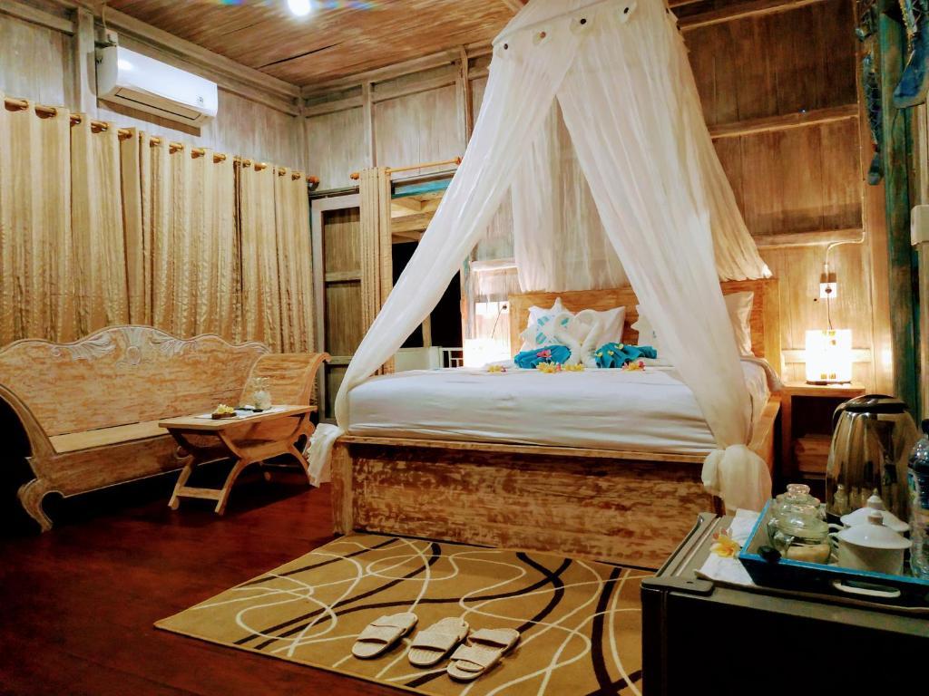 Ein Bett oder Betten in einem Zimmer der Unterkunft Golden Hill Cottage Nusa Penida
