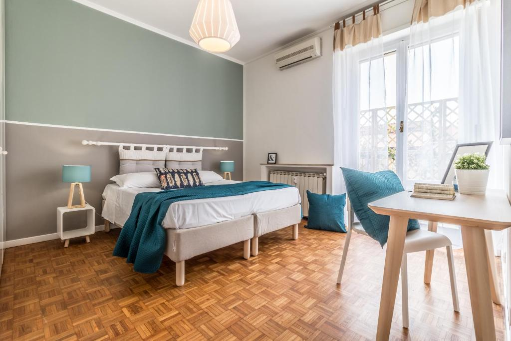 A bed or beds in a room at Homeathotel Citylife Colonna