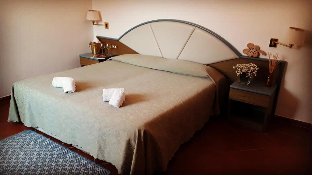 Un ou plusieurs lits dans un hébergement de l'établissement Hotel Bar Ristorante Pinocchio