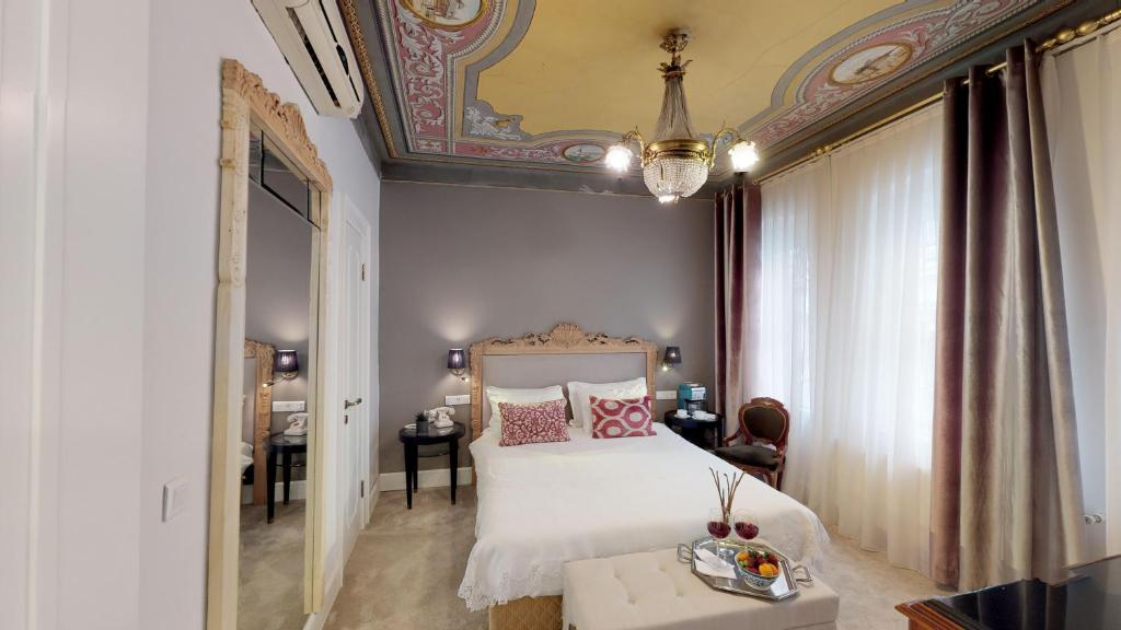 A bed or beds in a room at Faik Pasha Suites Special Category