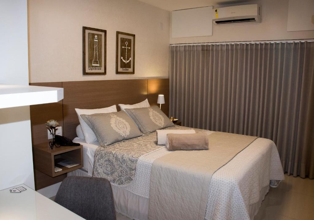 A bed or beds in a room at Ondina Apart Hotel - Apto. 537