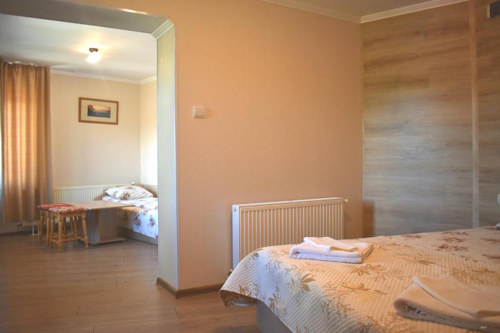 Cama o camas de una habitación en Hotel Slavianska dusha