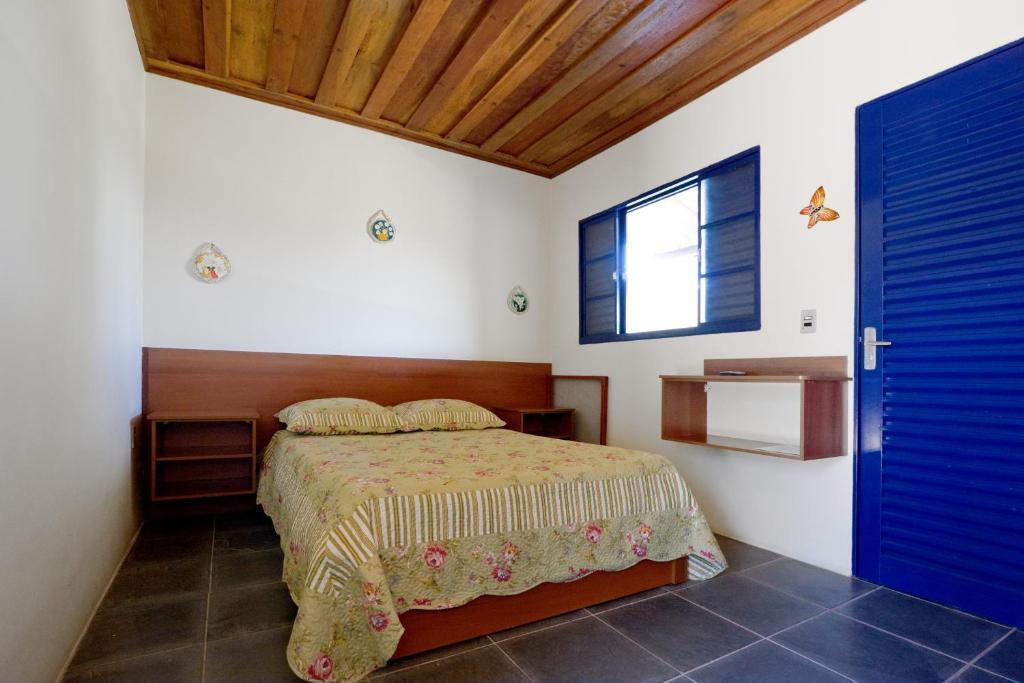 Cama ou camas em um quarto em Fazenda das Pedras - Apartamento