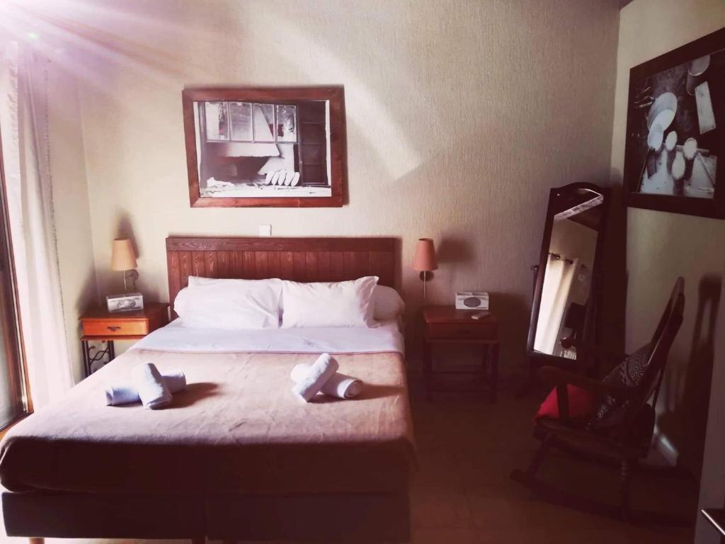A bed or beds in a room at Guesthouse Axieros