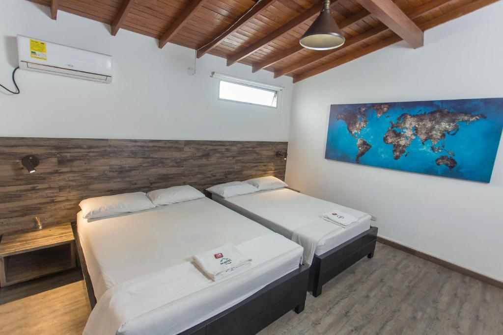 A bed or beds in a room at Montañita Hostel