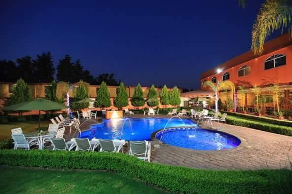 The swimming pool at or near Hotel Quinto Sol