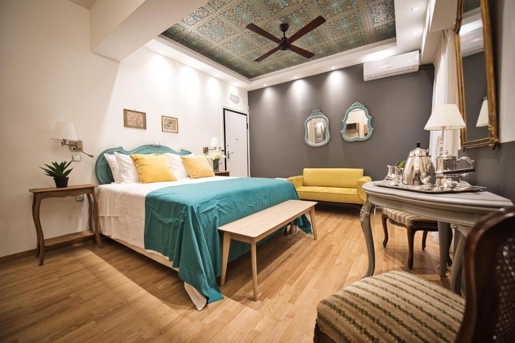 A bed or beds in a room at Rastoni Athens Suites near Acropolis at Tsatsou street