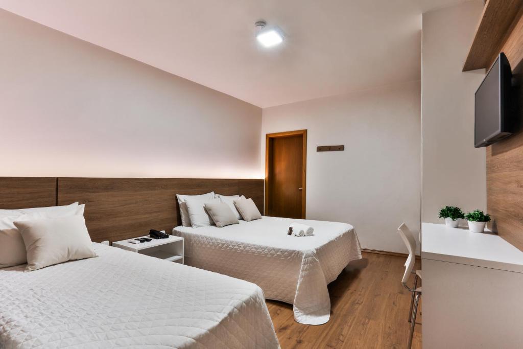 Cama ou camas em um quarto em Zallon Hotel Executivo