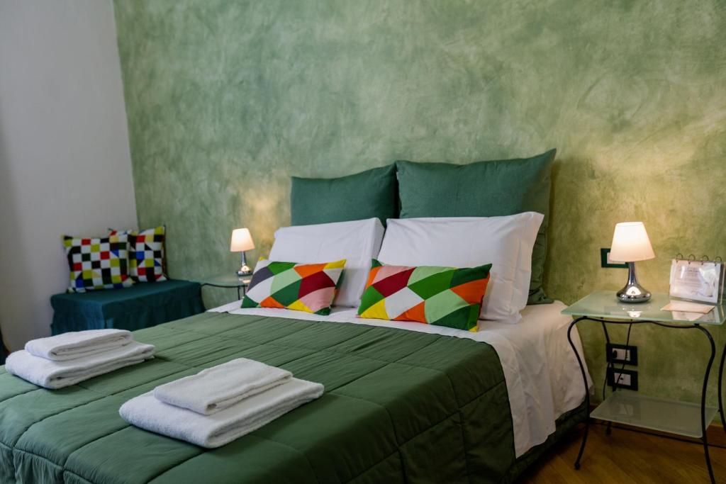 A bed or beds in a room at La Locandiera