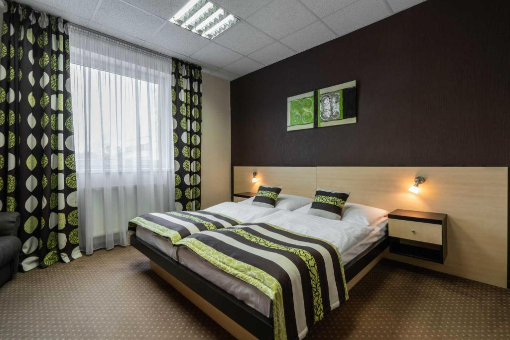 A bed or beds in a room at BNC Hotel - Restaurant - Bowling
