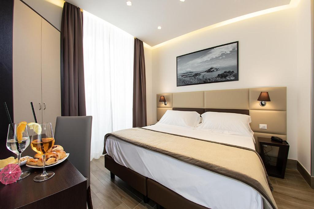 Ein Bett oder Betten in einem Zimmer der Unterkunft Hotel Palazzo Argenta