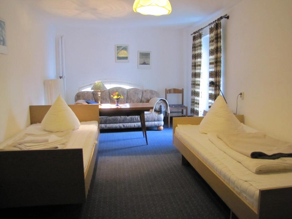 A bed or beds in a room at Haus Annaberg