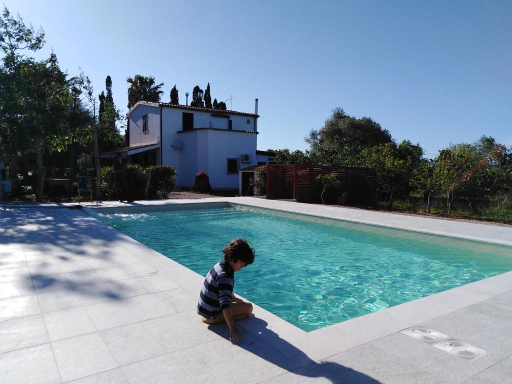 The swimming pool at or near B&B La Rucchetta