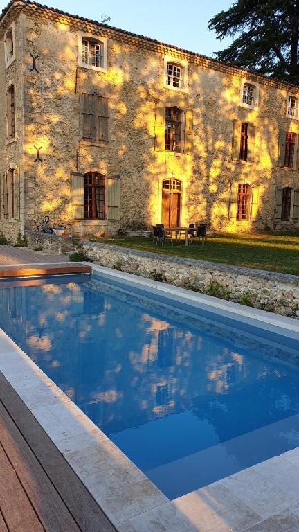 The swimming pool at or near la bastide de l'adrech