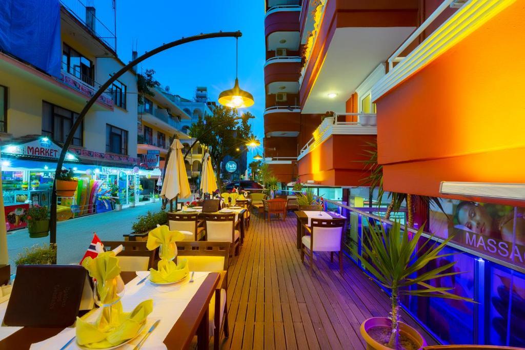 Ресторант или друго място за хранене в Twin Apart Hotel