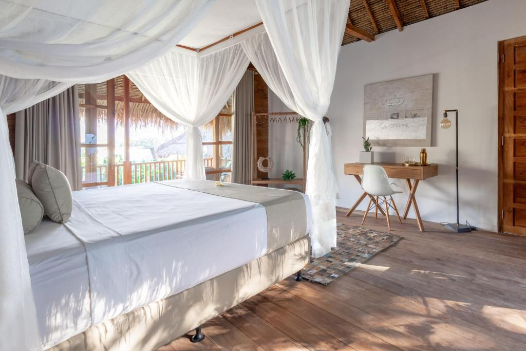 A bed or beds in a room at Balidroom Lodges