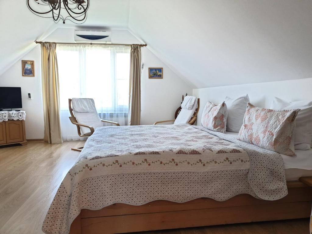 Кровать или кровати в номере Guest house Usadba Surikova