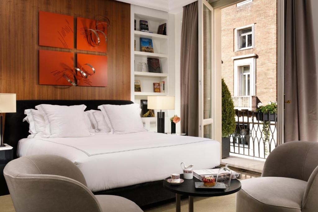 A bed or beds in a room at The First Roma Dolce