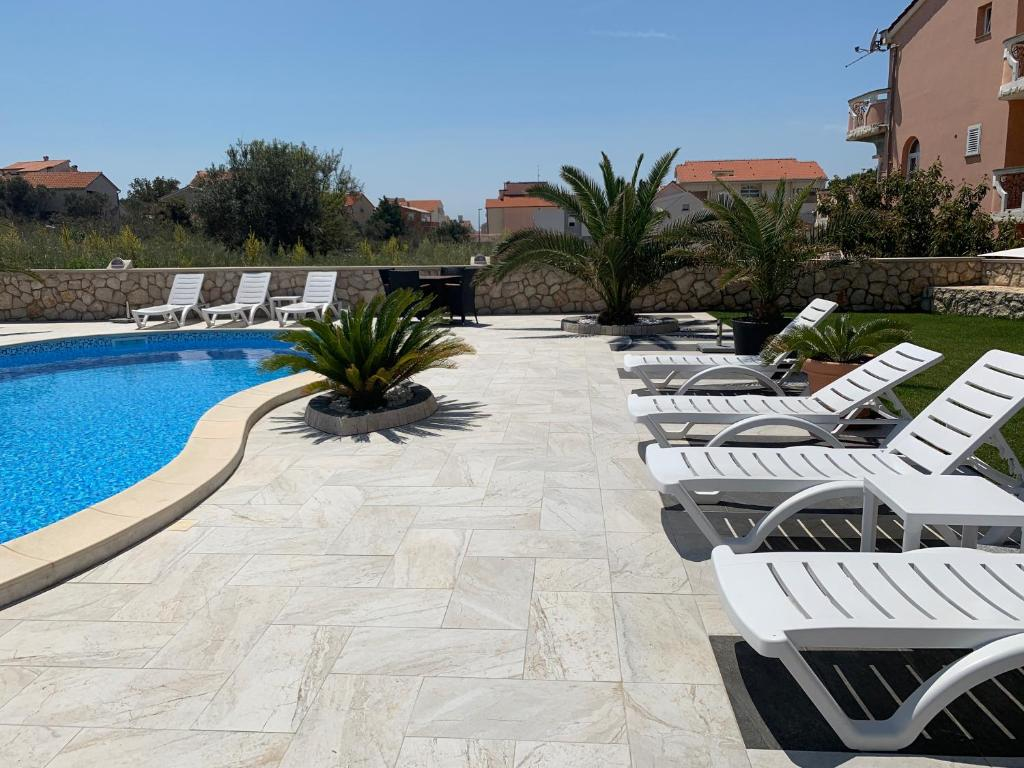 The swimming pool at or close to Apartments Albatross