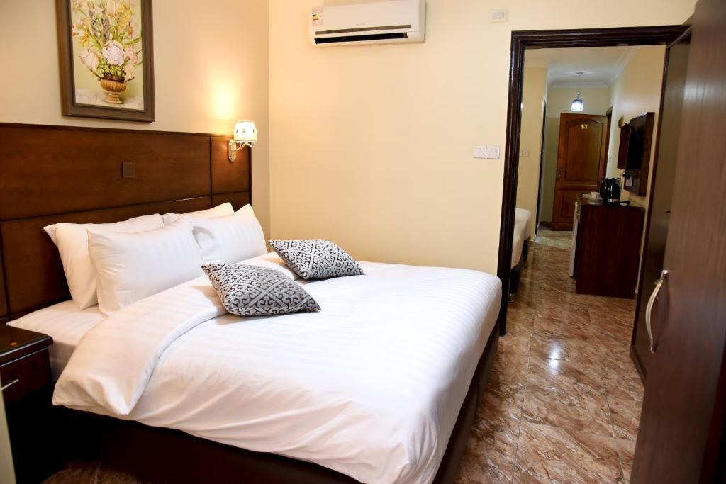Llit o llits en una habitació de Karam House