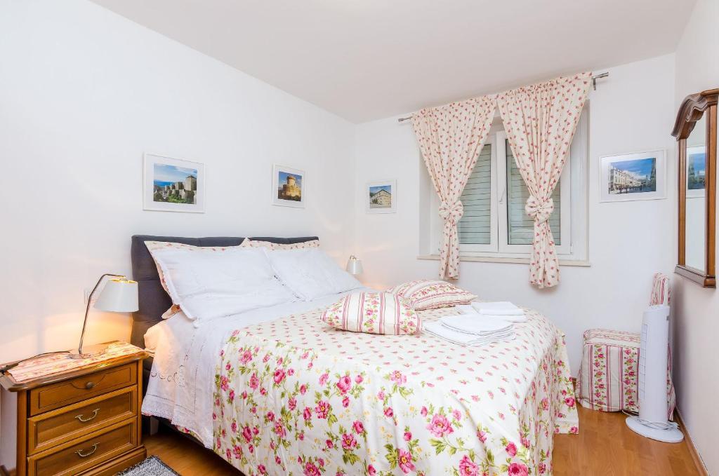 Cama o camas de una habitación en Apartments Captain