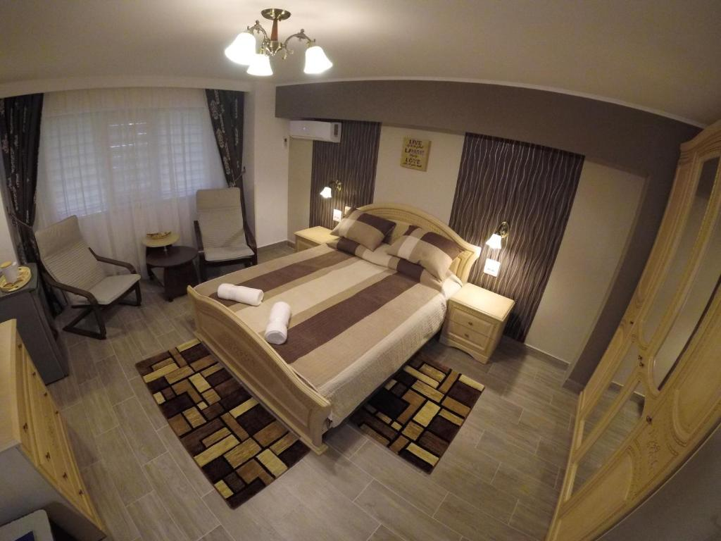 A bed or beds in a room at Residence ABBA Maritime