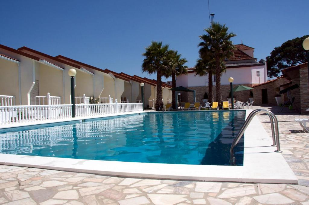 The swimming pool at or near Hotel Quinta dos Tres Pinheiros