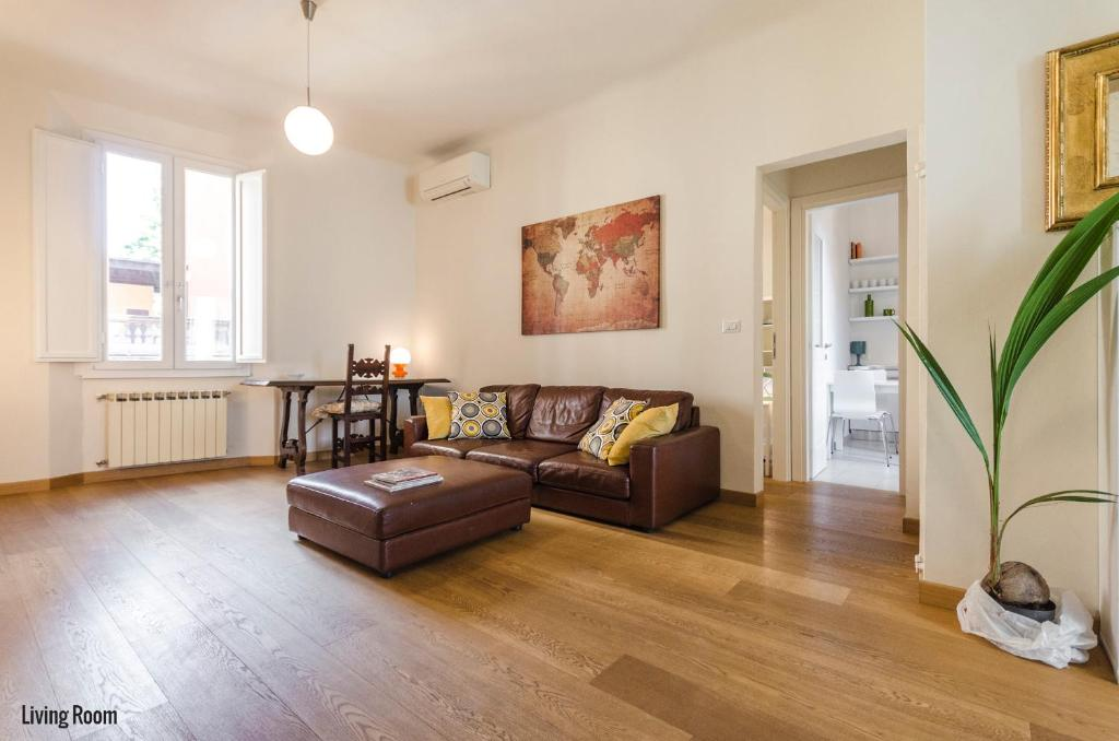 Area soggiorno di Frassinago Apartment