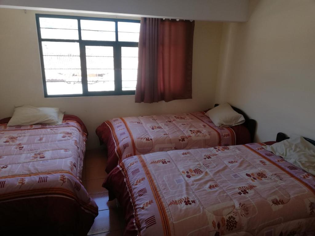 Cama o camas de una habitación en La Casa del Viajero Feliz