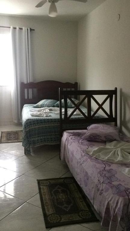 Cama ou camas em um quarto em HOTEL PRAIA GRANDE