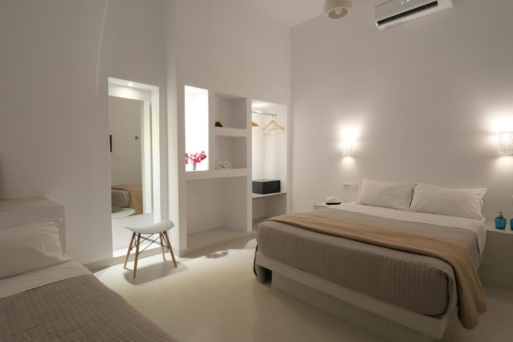 A bed or beds in a room at Santorini Spirit