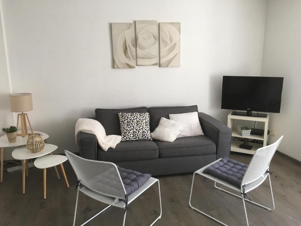 Ein Sitzbereich in der Unterkunft Au coeur de la Petite Venise