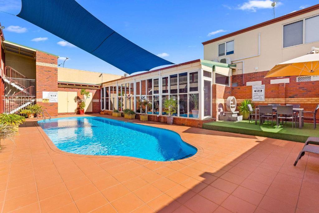The swimming pool at or near Quality Inn Railway Motel
