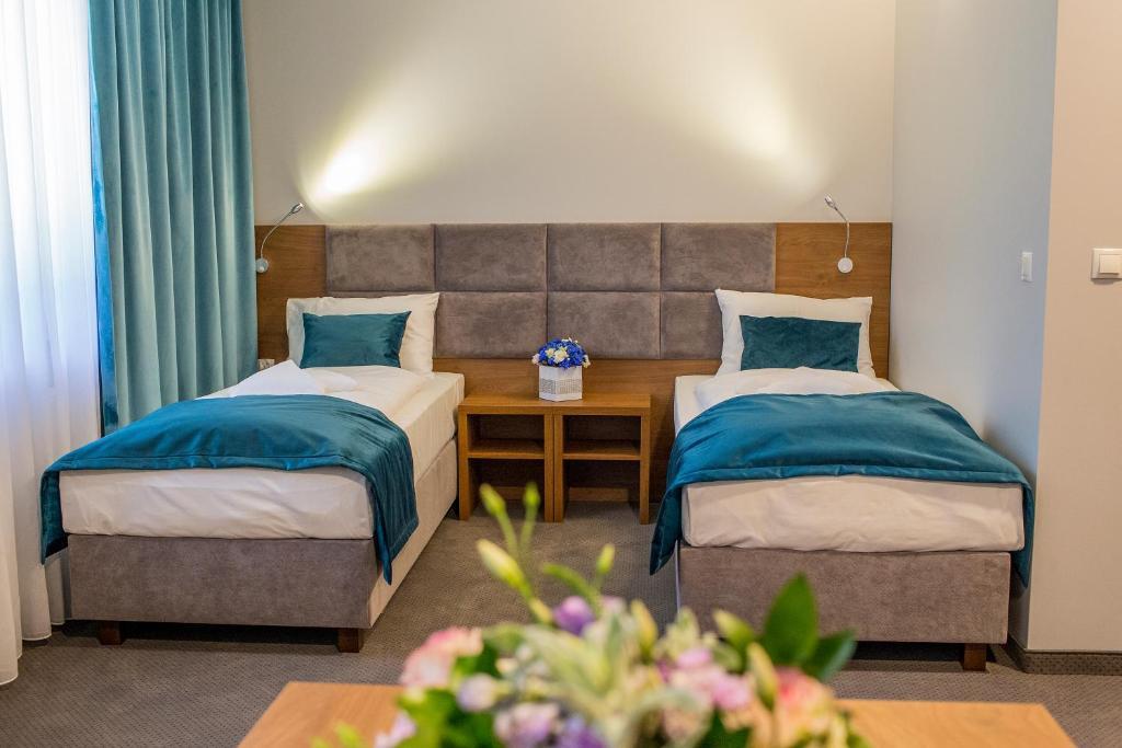 Łóżko lub łóżka w pokoju w obiekcie Stary Młyn