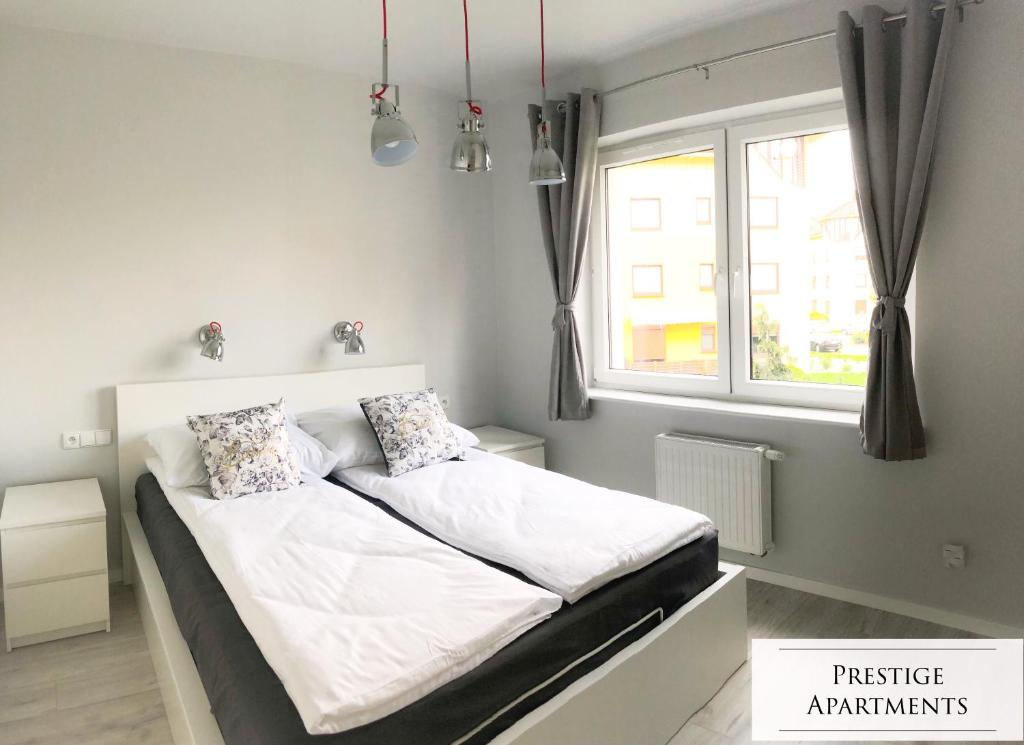 A bed or beds in a room at Exclusive Apartment